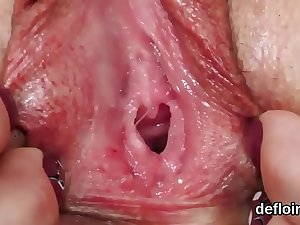 Pretty cutie opens up juicy pussy and gets deflowered